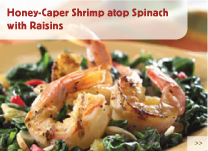 Honey-Caper Shrimp atop Spinach with Raisins